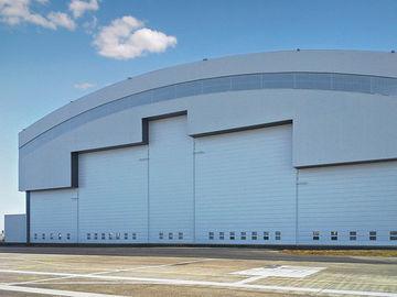 Ангары Айркрафта системы толя кривого Prefab стальные с электрическими дверями скольжения